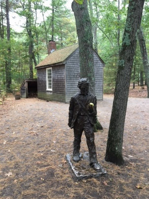 Replica of Thoreau's cottage and statue of Thoreau near Walden Pond.