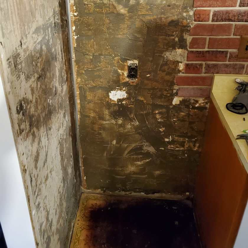 Unfortunate kitchen capers: behind my old fridge lurked thick layers of wall adhesive, while below it lurked the damage to the 1970s-era avocado flooring caused by old fridge cooking off the water it leaked. Writing Connections: DIY and Writing Part 2. Text and image by R. E. Gould